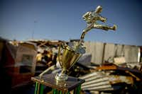 An off-kilter  martial arts trophy and so many other mementos were battered in the Dec. 26 tornado.(G.J. McCarthy - Staff Photographer)