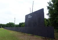 A huge plywood cutout of the USS Dallas attack submarine is sitting at a Riverfront Boulevard in Dallas.
