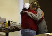 Alicea Whitener came to First Assembly of God for a meal and a blanket but also got a hug from Leticia Castillo (left).
