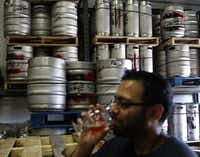 Jay Patel takes a drink at the Deep Ellum Brewing Co. in Dallas, Texas Saturday, May 19, 2012.