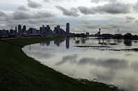 Floodwaters spread over the Trinity River floodplain near downtown on March 20 after an overnight storm system dumped rain across North Texas.