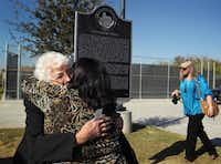 Marie Tippit (left), widow of Officer J.D. Tippit, hugged her daughter, Brenda Tippit, following the dedication ceremony last November for a historical marker for the slain officer in Oak Cliff.