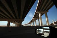 New bridges stretch toward D/FW Airport on westbound State Highway 114. The DFW Connector will double capacity on highways near the airport that already carry 180,000 drivers a day.