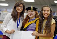 From left: Anahi Alvarez, Lilly Skinner and Naomi Martinez smile as they are recognized Tuesday by fellow Grand Prairie High students following an an anti-bullying rally. Alvarez and Martinez made a pact to cede the homecoming queen crown if they won it to Skinner, who had been nominated as a prank. Alvarez was elected queen and immediately gave the crown to Skinner.(G.J. McCarthy - Staff Photographer)