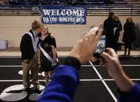 Madeline Braley got a kiss from Austin Igo before Plano West's homecoming celebration Friday night. The seniors have known each other since birth.