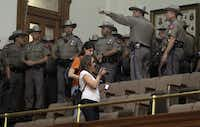 State troopers entered the gallery to try to restore order after the special session ended at midnight Tuesday.