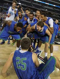 Florida Gulf Coast's Chase Fieler (25) videotaped his teammates as they clowned around at the end of practice as the Eagles prepared for the next round of the NCAA Tournament at Cowboys Stadium in Arlington.