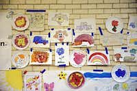 Drawings made by migrant children hang on a wall at Sacred Heart Catholic Church Wednesday, July 2, 2014 in McAllen, Texas.G.J. McCarthy  -  Staff Photographer
