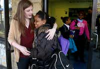 Abilene Christian University student Molly Clemans hugged St. Anthony School student Alana Roberts after a Design for Change session.