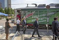 Dallas officials rode the M-Line trolley to Klyde Warren Park on Friday. The M-Line expansion is the second major transit project to open in downtown this year. DART started an Oak Cliff streetcar that it hopes to connect with the trolley.( G.J. McCarthy  - Staff Photographer)