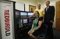 Tamy Smalskas, director of career and technical  education for McKinney ISD; Fritz Mowery, a McKinney business partner; and Patrick Arnzen, of US Sport Aircraft are on board with the flight simulator.