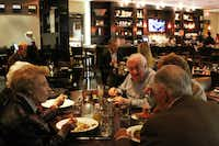 Nosh Euro Bistro in Plano, is larger and more spacious than its Oak Lawn sister, with a vibrant, warm, contemporary bistro feel, with glossy wood tables and Riedel wine glasses.