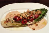 On the regular menu, a grilled hearts of romaine salad, rubbed with charred lemon then grilled and topped with sweet Jonah crab meat and the right amount of roasted shallot dressing, with charred cherry tomatoes