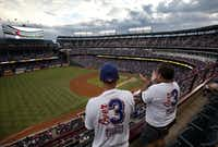 Rangers fans Chad and Kent Gilley of Azle were among the 36,102 spectators who pushed the team's season attendance to 3,003,143.