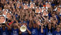 Coppell Cowboys fans held pictures of Jacob Logan before the team played Flower Mound on Friday night.