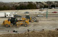 Heavy equipment, cars and trucks share the road on U.S. 75 in McKinney.