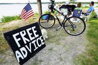 The homemade sign at White Rock Lake catches the attention of many people who drop in for free life advice from one of two lifelong pals -- Neal Caldwell and Roderick MacElwain. Sometimes a line forms.