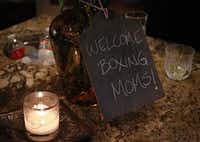 "A hand-written chalkboard sign welcomes attendees to a ""boxing club"" get-together Tuesday, April 23, 2013 in Dallas. The group of five mothers, who call themselves the ""Boxing Moms,"" have gathered regularly for the last three years to make care packages for their children in college."