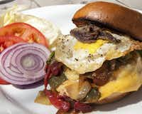 Towering Inferno Burger at Burger Bar & Fish restaurant in Snowmass is topped with  a fried egg and more.