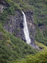 The Rjoande Waterfall near HŒreina has a vertical drop of 140 meters. FlŒm valley, Norway.
