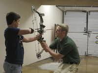 A young archer tries out a new bow at Bass Pro Shops Outdoor World in Springfield.BASSPROSHOPS Email: traceydteo@yahoo.com Phone: 812 205-6867 Byline: Wesley K.H. Teo Submitter: Tracey Teo Section: TRAVEL_NTR