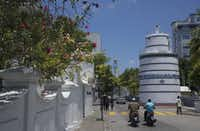 The squat minaret of the 450-year-old Friday Mosque overlooks traffic in the low-key Maldivian capital of Male.