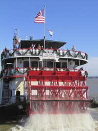 Bedecked with garlands and big red bows, the Steamboat Natchez takes Christmas Eve diners for a cruise on the Mississippi.