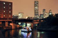 A quiet, uncrowded way to see the lights in Houston is a pontoon cruise on Buffalo Bayou.