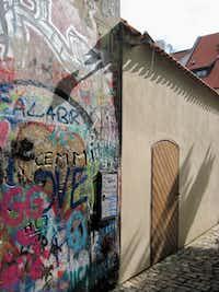 """A view of the end of Prague's """"Lennon Wall"""": an impromptu message board and canvas for street art on the city's Velkopřevorské náměstí."""