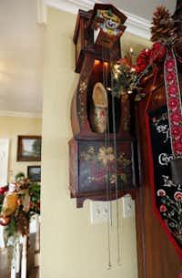 A handmade wooden cuckoo clock was handpainted by Geisler's sister.
