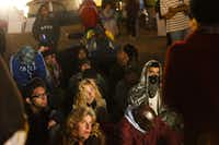 Syrian activist Rania Kisar (back to camera, right) spoke to a crowd of Occupy Dallas protesters and showed YouTube videos demonstrating the violence and brutality faced by protesters in Syria during a teach-in at the Occupy Dallas campsite Thursday night.