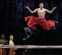A performer on stilts jumps over a log during a preview of Cavalia's production Odysseo in Frisco, Texas on Jan. 27, 2015.(Rose Baca - The Dallas Morning News)