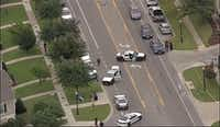 Dallas police investigate a shooting by an officer in the 1100 block of North Bishop Avenue Tuesday afternoon. (NBC 5)