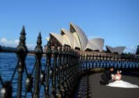 A bride and groom pose in front of the Sydney Opera House, a relatively modern wonder built in 1973. Performances and programs are also family-friendly.Saeed Khan  - Presse