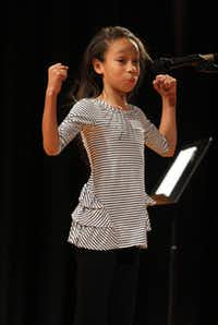 Marisa Dixon, 11, recited her piece in the sixth-grade oratorical contest Friday at  W.H. Atwell Law Academy in Oak Cliff.
