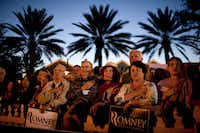 Supporters of Mitt Romney recite the Pledge of Allegiance before a campaign stop in The Villages, Fla., on Monday.