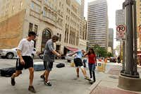 """From left: Jay Mason, Steven Smith, Bruce Lobdell and Alma Terrazas played soccer on Main Street during """"Park(ing) Day"""" on Friday. Their goal: Transform a parking space into something more enjoyable. A pumpkin patch popped up in another slot."""