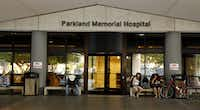 People wait outside Parkland, which faces an order to correct deficiencies fast or lose crucial Medicare and Medicaid funding.
