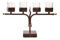 Light it up: Hand-crafted in Mexico, the wrought iron Four Veladora candelabra designed by Jan Barboglio adds festive light to a mantel or table. 16 inches wide. $275 at Culinary Connection, Plano.