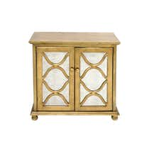 Gold standard: For welcoming guests in an entrance hall, a classic cabinet with hand-applied, gold-leaf finish and antiqued, mirrored front is an elegant accent. An interior shelf is hidden behind double doors. 29.25 by 15.25-by 30 inches. $349.95 at I.O. Metro, Dallas and Fairview