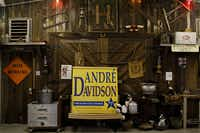 A campaign sign for Plano City Council member André Davidson stands among sundry antiques at the Haggard Party Barn Tuesday, March 1, 2011 in Plano.