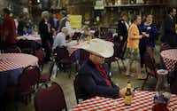 Phillip Pierceall passes time on his mobile phone as he waits for a campaign event to begin at the Haggard Party Barn Tuesday, March 1, 2011 in Plano.