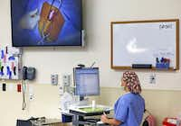 Sunny Austin, a registered nurse, uses the computer at Texas Health Arlington Memorial Hospital. Patients at the hospital were among the least likely to die in the hospital from serious but treatable complications among surgical patients, according to an analysis by The News.( Vernon Bryant  -  Staff Photographer )