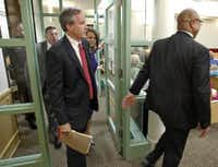 Texas Attorney General Ken Paxton (left) arrives in district court in Fort Worth on Aug. 27 for arraignment. (Pool Photo, Star-Telegram/Paul Moseley)