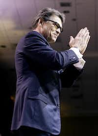 Gov. Rick Perry touted Texas' successes, as well as those of his fellow Republican governors, at the Conservative Political Action Conference on Friday in Oxon Hill, Md.(Drew Angerer - The New York Times)
