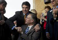Gov. Rick Perry (left) and Attorney General Greg Abbott together in 2010.