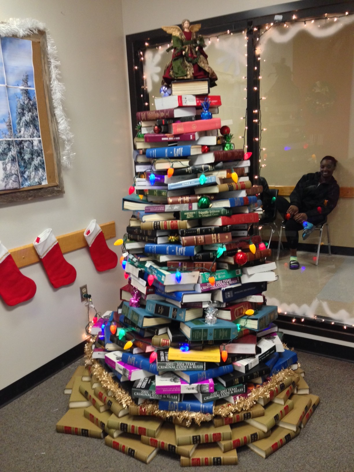 dallas county public defenders office displays christmas tree made of law books crime dallas news