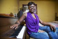 Sheena Boyd of Dallas was one of Carolyn Harris' students who received a piano when she entered Booker T. in 2000.Brandon Wade  -  Special Contributor