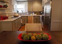 Susan Sessler's kitchen received a lot of attention in the renovation and features updated cabinets and counters. Appliances also were relocated.Mona Reeder - Staff Photographer