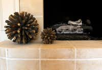 Accessories from West Elm accent the newly refaced fireplace.Mona Reeder  -  Staff Photographer
